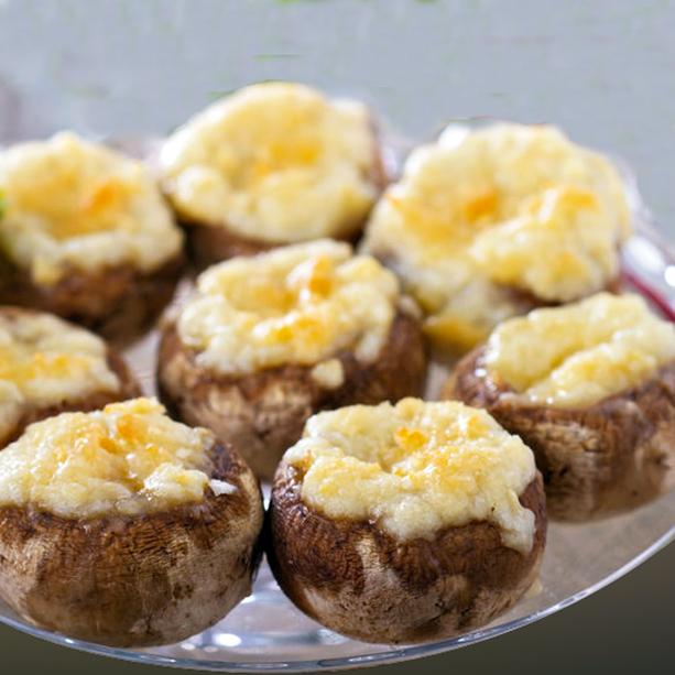 Champiñones rellenos al horno con jamón y queso